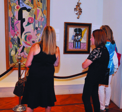 Visitors in the gallery at Nassau County Museum of Art