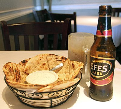 Warm pita perfectly pairs with a dark Persian beer.