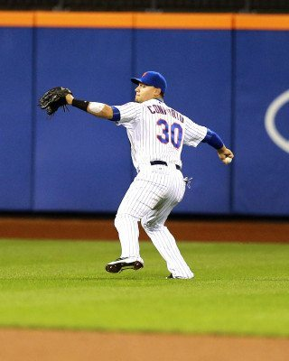New York Mets LF Michael Conforto (30) makes catch and fires a throw to hom e plate in the sixth inning of a baseball game against the Atlanta Braves at Citi Field in New York, Wednesday, Sept. 23, 2015. (Gordon Donovan)
