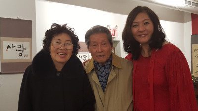 Soh Young with her mom and dad at the Korean exhibition in the Flushing Town Hall.