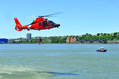 Coast Guard Sector, New York, Search and Rescue Team performs search and rescue aviation demonstrations on the Hudson River as a part of Fleet Week New York (FWNY). FWNY, now in its 27th year, is the city's time honored celebration of sea service. It is an unparalleled opportunity for the citizens of New York and the surrounding tri-state area to meet Sailors, Marines and Coast Guardsmen, as well as whitness first hand the latest capabilities of today's maritime service. (US Navy photo by Mass Communication Specialist 1st Class Gina Danals/Released)