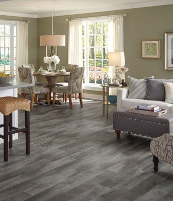 Mannington's Adura Collection in Seaport Anchor offers luxury vinyl plank in a modern salvaged look.