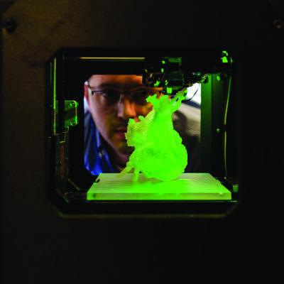 A researcher monitors the 3D bioprinting process.