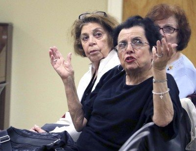 Louise LaGatta makes a point about the existing traffic problems in the area around the Hicksville Sears store, while Mary Garone, behind her, waits her turn to speak at the Hicksville Community Council meeting on May 5. Both speakers foresaw even worse congestion if the plans proposed by the owners of the Sears property came to pass. (Photo by Frank Rizzo)