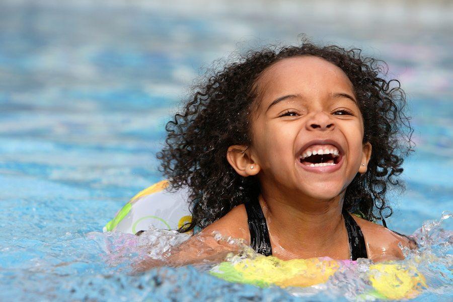 Child having fun swimming in a pool