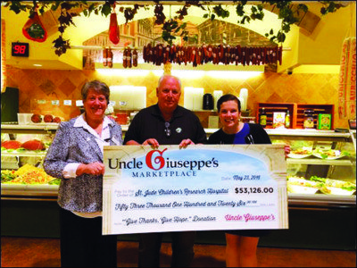 Uncle Guiseppe's presents check to St. Jude