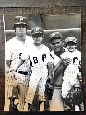 Aaron Boone (far right), held by grandfather Ray and flanked by brother Bret, standing in front of father Bob.