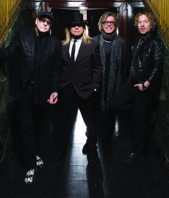 Cheap Trick (from left): Rick Nielsen, Robin Zander, Tom Petersson, Daxx Nielsen (Photo by David McClister)