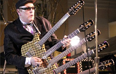 Rick Nielsen with one of his 400 to 500 guitars.