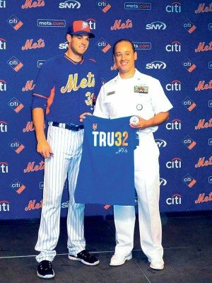 A Tru32 honoree poses with the NY Met.