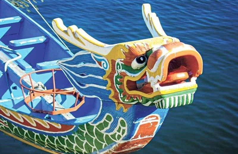A decorative boat figurehead in the style of a Chinese Traditional Dragon on the Sea.