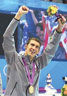 LONDON, ENGLAND - JULY 31: Michael Phelps of the United States celebrates after winning the gold in the Men's 4 x 200m Freestyle Relay final on Day 4 of the London 2012 Olympic Games at the Aquatics Centre on July 31, 2012 in London, England. (Photo by Al Bello/Getty Images)