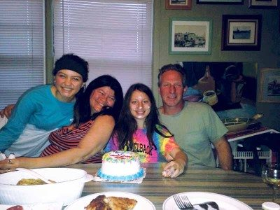 Nelly Romero with her daughters Nora, 11, Nicole, 14, and her husband Anthony.