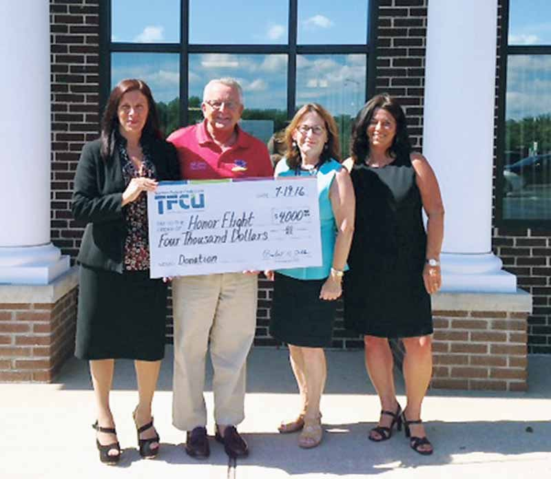 A donation check for $4,000 raised by Team TFCU was presented to Honor Flight, a nonprofit organization based in Southampton, at TFCU's Riverhead Branch. Pictured: Santa Rodriguez of TFCU, Bill Jones and Virginia Bennett of Honor Flight and Jennifer Gunn of TFCU.