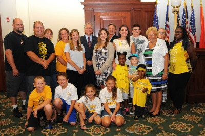 Pictured along with County Executive Mangano, are: County Legislator Rose Marie Walker; members of the Winthrop University Hospital Cancer Center for Kids—Dana Epstein, Development; Ashley Carlo, Manager; Heather Maloney, Development; Nancy Morreale, LCSW; The Nedd Family; The Spencer Family; The Cicero Family; The Lang Family; and Peter Riley.