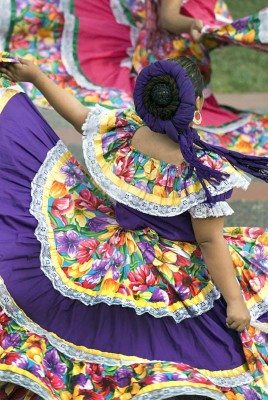 A girl performs in a traditional Mexican dance.