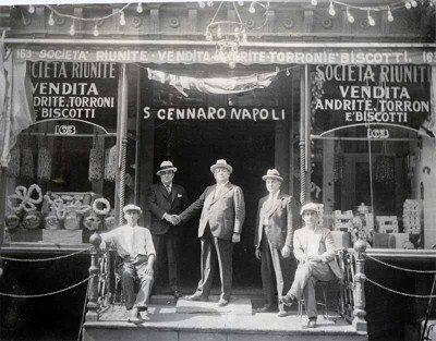 Francisco Caserta, center, the First President of the Feast of San Gennaro where he lived at 163 Mulberry Street. Circa 1926. (Photo by Looking Back Project NYC).