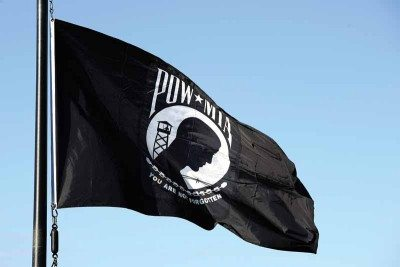 A POW/MIA flag flies over Schriever Air Force Base, Colo., Sept. 15, 2014, in remembrance of the nation's prisoners of war and missing in action. (U.S. Air Force photo by Dennis Rogers/Released)