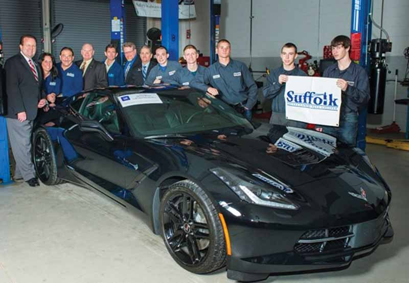 Suffolk County Community College Automotive Technology students with a 2015 Chevrolet Corvette donated by General Motors and used for training. Suffolk is a certified trainer for Toyota, General Motors and Honda.