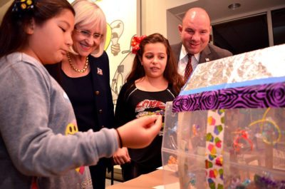 North Hempstead Supervisor Judi Bosworth and Council Member Peter Zuckerman view recycled art creations.