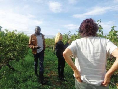 Natalia (center) with her mother on a vineyard tour in Kenya.
