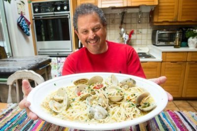 Bert Spitz and a dish of pasta with white clam sauce he whipped up