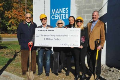 Board members with Dr. Harvey Manes and the donation check.