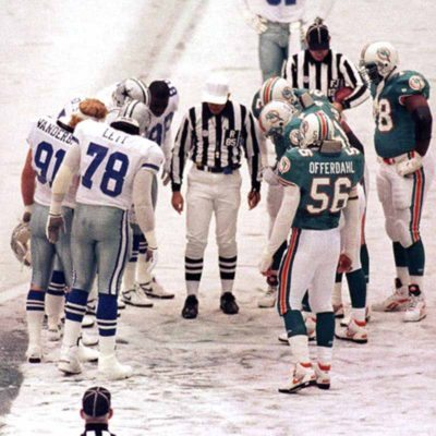 FILE - In this Nov. 25, 1993 file photo, The Dallas Cowboys and Miami Dolphins meet on the icy field of Texas Stadium for an NFL football game on Thanksgiving Day in Irving, Texas. After blocking a field goal attempt with 15 seconds left in a snowy game, the Cowboys appear to have the win. But Leon Lett slides into the ball, which is now live; the Dolphins recover and Pete Stoyanovich kicks a game-winning 20-yard field goal with 3 seconds left. Dolphins win 16-14. (AP Photo/Glenn James, File)