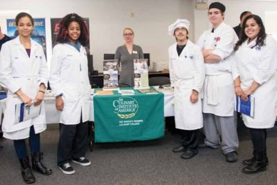 Culinary students at Nassau BOCES Barry Tech review admissions materials with a representative of the prestigious Culinary Institute of America at the second annual Barry Tech College Fair.